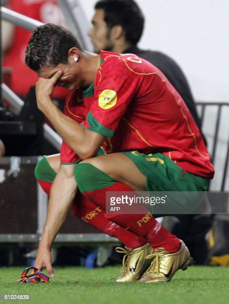 Portuguese forward Cristiano Ronaldo cries 04 July 2004 at the Luz stadium in Lisbon after the Euro 2004 final football match between Portugal and...