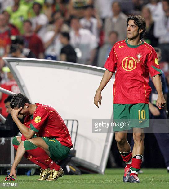 Portuguese forward Cristiano Ronaldo cries as midfielder Rui Costa looks dejected, 04 July 2004 at the Luz stadium in Lisbon after the Euro 2004...