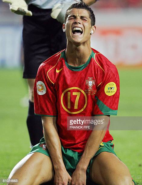 Portuguese forward Cristiano Ronaldo rues a missed opportunity 04 July 2004 at the Luz stadium in Lisbon during the Euro 2004 final match between...