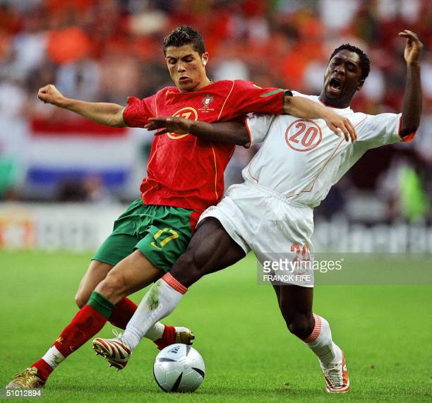 Portuguese forward Cristiano Ronaldo vies with Dutch midfielder Clarence Seedorf 30 June 2004 at the Alvalade stadium in Lisbon during the Euro 2004...