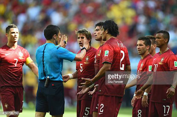 Portugal protest the call of referee Milorad Mazic after awarding a penalty kick to Germany during the 2014 FIFA World Cup Brazil Group G match...