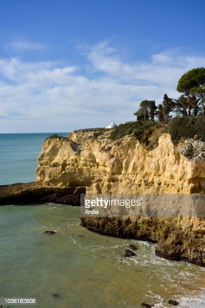 Portugal region of the Algarve Armacao de Pera Chapel of Nossa Senhora da Rocha white chapel atop the cliff