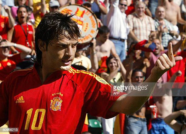 Spain's striker Fernando Morientes celebrates 16 June 2004 at Bessa stadium in Porto after scoring the opening goal during his team's Euro 2004 Group...