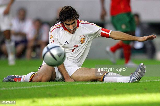 Spain's striker Raul stares at the ball as he lies on the field 20 June 2004 at Jose Alvalade stadium in Lisbon during his team's Euro 2004 group A...
