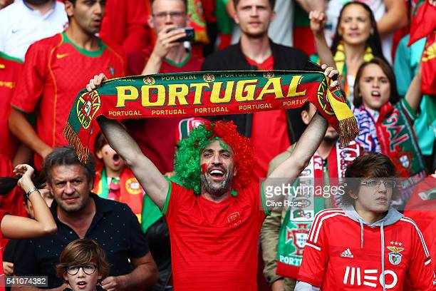 Portugal supporter enjoys the pre match atmosphere during the UEFA EURO 2016 Group F match between Portugal and Austria at Parc des Princes on June...