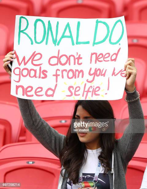 Portugal supporter raises a sign asking Cristiano Ronaldo of Portugal to take a selfie with her prior to the FIFA Confederations Cup Russia 2017...