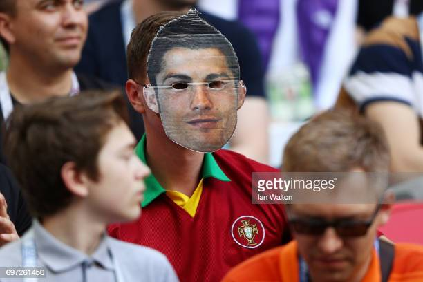 Portugal supporter wearing a Cristiano Ronaldo mask is seen prior to the FIFA Confederations Cup Russia 2017 Group A match between Portugal and...