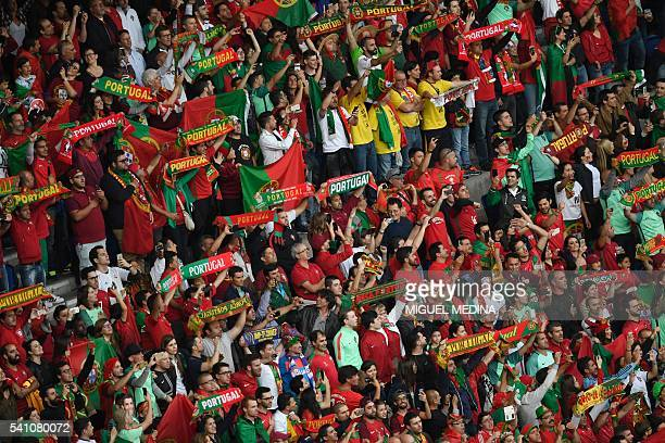 Portugal supporters cheer prior to the Euro 2016 group F football match between Portugal and Austria at the Parc des Princes in Paris on June 18,...