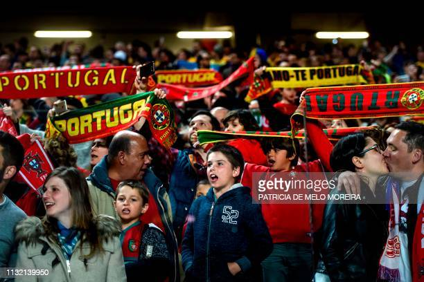 Portugal supporters sing the national anthem before the Euro 2020 group B qualifying football match between Portugal and Ukraine at the Luz stadium...