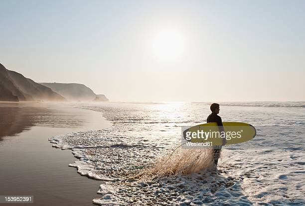 portugal, surfer on beach - sagres stock pictures, royalty-free photos & images