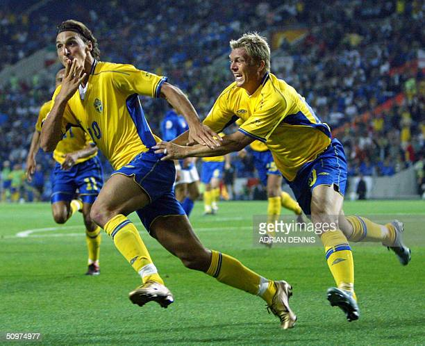 Sweden's striker Zlatan Ibrahimovic celebrates with his teammate striker Marcus Allback after scoring a goal against Italy 18 June 2004 during their...