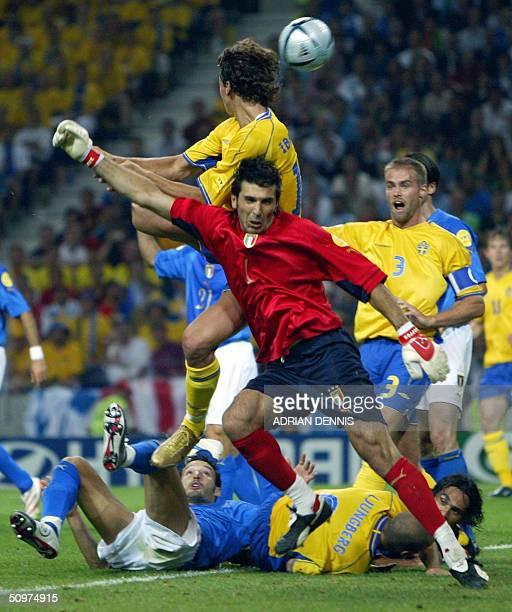 Sweden's striker Zlatan Ibrahimovic scores a goal against Italy despite of Italy's goalkeeper Gianluigi Buffon, 18 June 2004, during their European...