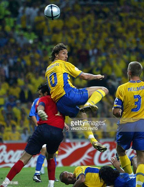 Sweden's striker Zlatan Ibrahimovic scores a goal against Italy despite of Italy's goalkeeper Gianluigi Buffon 18 June 2004 during their European...