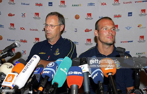 Swedish coach Lars Lagerbaeck and midfielder Fredrik Ljungberg face a crowd of microphones during a press conference in Villamoura on the Algarve...