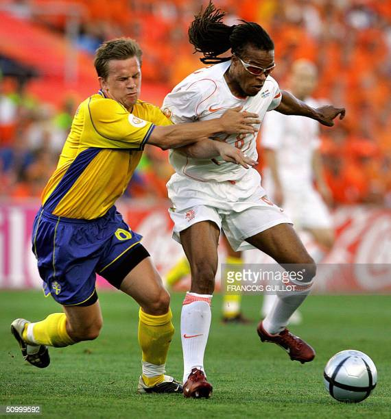 Swedish midfielder Anders Svensson vies with Dutch midfielder Edgar Davids 26 June 2004 at the Algarve stadium in Faro during the Euro 2004 quarter...