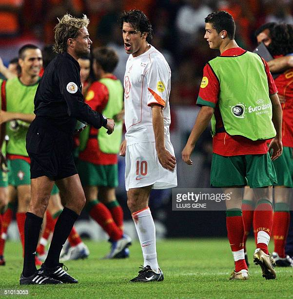 Swedish Referee Anders Frisk speaks to Dutch forward Ruud Van Nistelrooy and Portuguese forward Cristiano Ronaldo after Portugal won 21 30 June 2004...
