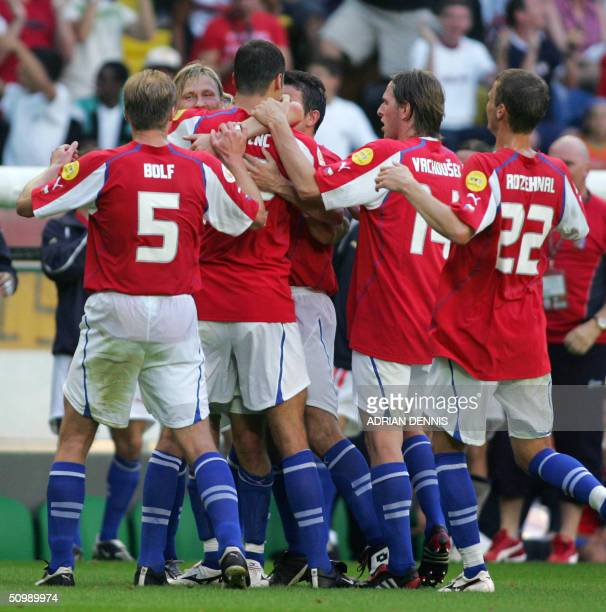 The Czech team celebrate after forward Heinz Marek scored against Germany, 23 June 2004 during their European Nations football championships match at...