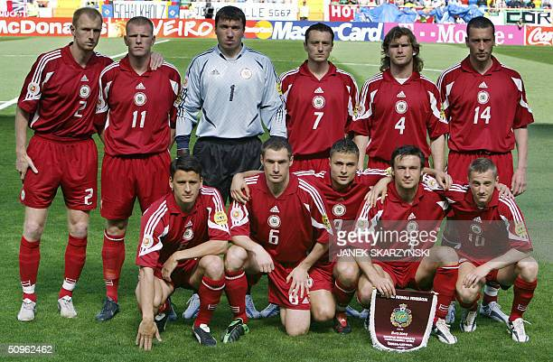 The Latvian team poses for photographerts 15 June 2004 at the Aveiro municipal stadium in Aveiro prior to their opening match against the Czech...