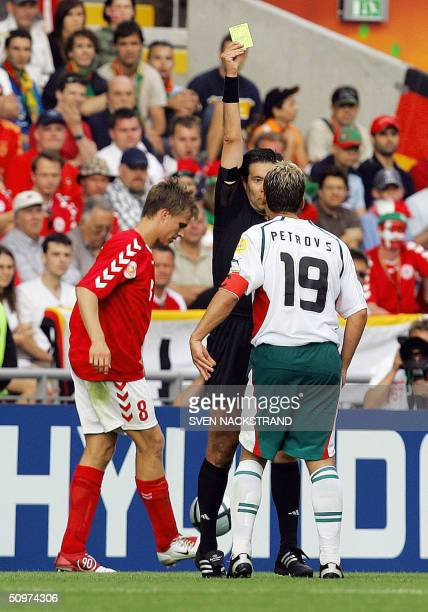 the Portuguese referee Lucilio Batista gives a second yellow card to Bulgaria's midfielder and captain Stilian Petrov as he protests against his...