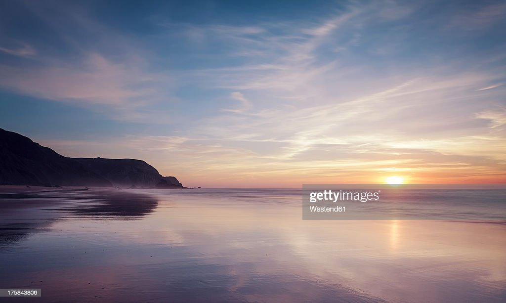 Portugal, View of Praia do Castelejo at sunset : Stock Photo