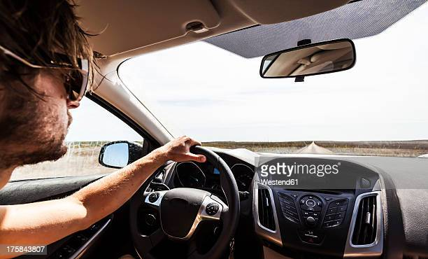 Portugal, Young man driving car on road