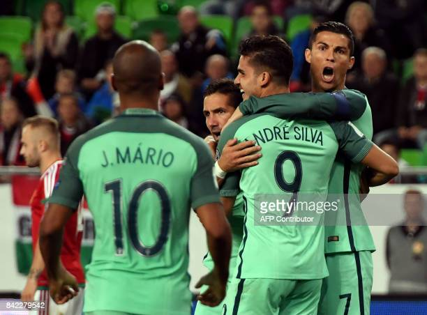 Portugal's André Silva celebrates scoring with teammates including captain Cristiano Ronaldo and João Mário during the FIFA World Cup 2018...