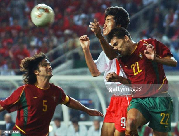 Portugal's Beto beats Korea's Seol Ki Hyeon to the ball as Fernando Couto watches14 June 2002 at the Incheon Munhak Stadium in Incheon during first...