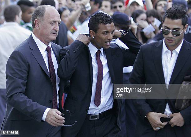 Portugal's Brazilian coach Luiz Felipe Scolari and players 'Nani' Cunha and Ricardo Quaresma arrive at Portela airport in Lisbon on June 20 2008...