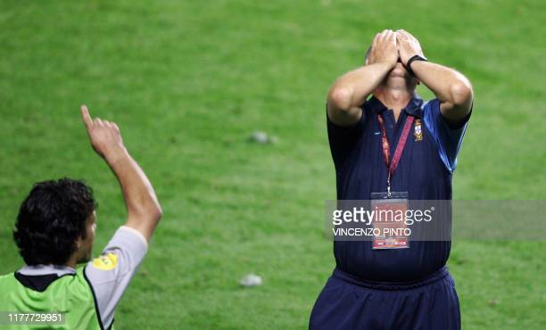 Portugal's Brazilian head coach Luiz Felipe Scolari reacts 04 July 2004 at the Luz stadium in Lisbon at the end of the Euro 2004 final match between...