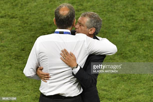 Portugal's coach Fernando Santos and Iran's Portuguese coach Carlos Queiroz embrace after the Russia 2018 World Cup Group B football match between...