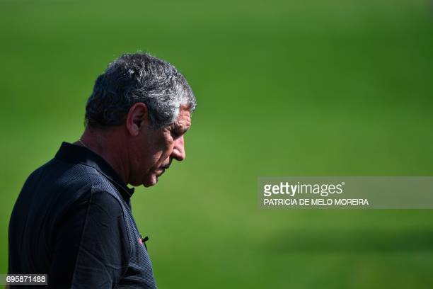 Portugal's coach Fernando Santos arrives for a training session at 'Cidade do Futebol' training camp in Oeiras outskirts of Lisbon on June 14 2017...