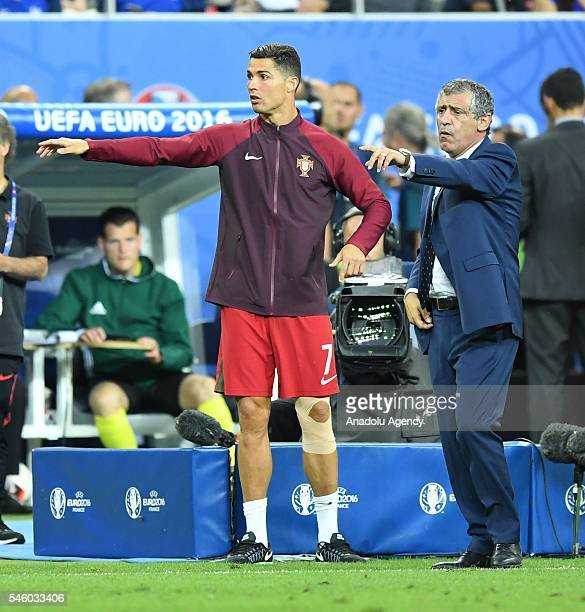 Portugal's Cristiano Ronaldo and head coach of Portugal Fernando Santos are seen during the Euro 2016 final football match between Portugal and...