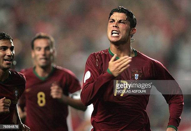 Portugal's Cristiano Ronaldo celebrates after he scored against Poland making 21 during their Euro 2008 qualification match at the Luz stadium in...