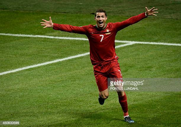 Portugal's Cristiano Ronaldo celebrates after scoring the 23 at the Friends Arena in Solna near Stockholm on November 19 2013 during the FIFA 2014...