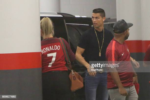 Portugal's Cristiano Ronaldo chats with his family in the park garage after the 2018 FIFA World Cup qualifying football match between Portugal and...