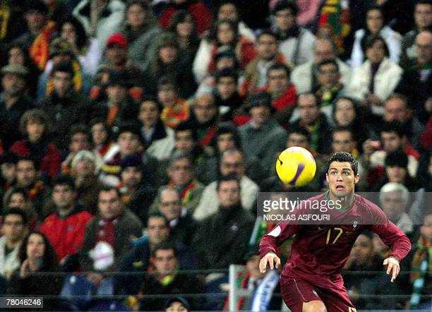 Portugal's Cristiano Ronaldo controls the ball during their Euro 2008 qualifying football match at the Dragao stadium in Porto 21 November 2008 The...