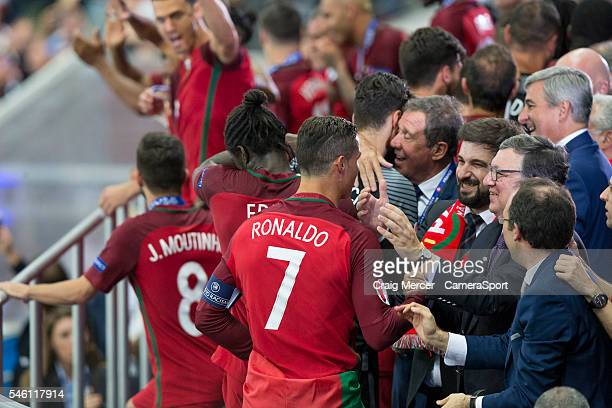 Portugal's Cristiano Ronaldo goes up to collect his winners medal during the UEFA Euro 2016 Final match between Portugal and France at Stade de Lyon...