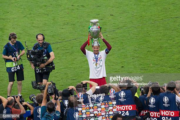 Portugal's Cristiano Ronaldo poses with the winners trophy during the UEFA Euro 2016 Final match between Portugal and France at Stade de Lyon on July...
