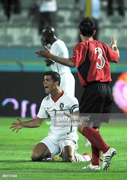 Portugal's Cristiano Ronaldo reacts next to Albania's Kristi Vangjeli during their World Cup qualifing football match at the Qemal Stafa stadium in...