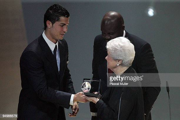 Portugal's Cristiano Ronaldo receives the FIFA Fair Play trophy 2009 from the hands of Elisabeth Puskas and Georges Weah during the FIFA World Player...
