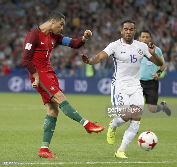 Portugal's Cristiano Ronaldo shoots past Jean Beausejour of Chile during the second half of a Confederations Cup semifinal match in Kazan Russia on...