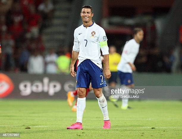 Portugal's Cristiano Ronaldo smiles during the Euro 2016 qualifying football match between Albania and Portugal at the Elbasan Arena in Elbasan on...