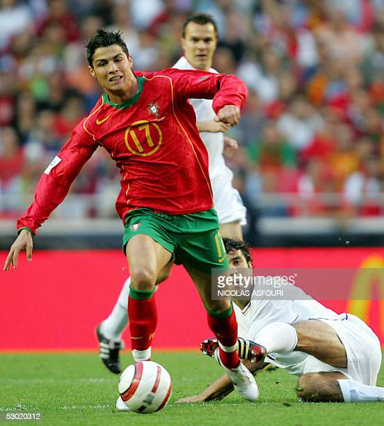 Portugal's Cristiano Ronaldo vies for the ball with Slovakia's Hlinka Peter during their World Cup 2006 qualifier football match at the Luz stadium...