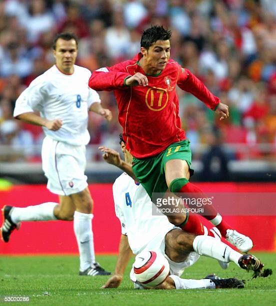 Portugal's Cristiano Ronaldo vies with Slovakia's Hlinka Peter during their World Cup 2006 qualifier football match at the Luz stadium in Lisbon 04...