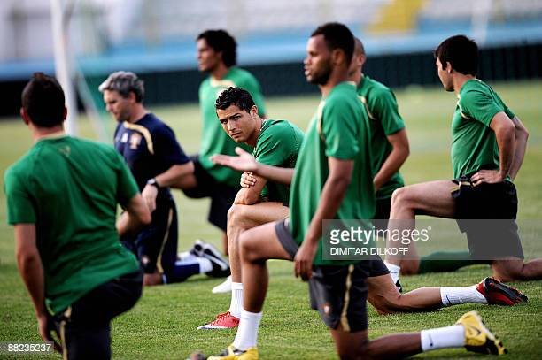 Portugal's Cristiano Ronaldo warms up with teammates during a training session at the Qemal Stafa stadium in Tirana on June 5 prior to their World...