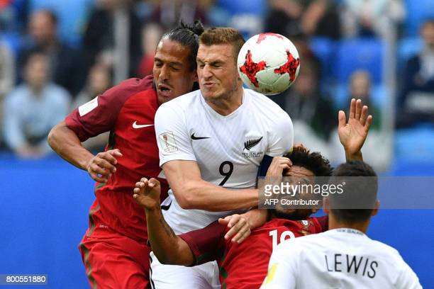 Portugal's defender Bruno Alves and Portugal's defender Eliseu vie with New Zealand's forward Chris Wood during the 2017 Confederations Cup group A...