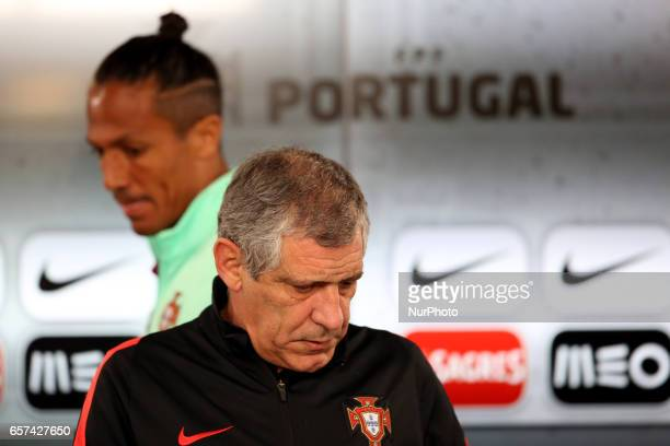 Portugals defender Bruno Alves and Portugals head coach Fernando Santos attend a press conference at the Luz stadium in Lisbon Portugal on March 24...