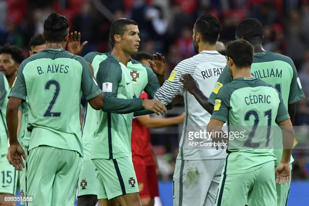Portugal's defender Bruno Alves Portugal's forward Cristiano Ronaldo Portugal's goalkeeper Rui Patricio Portugal's defender Cedric and Portugal's...