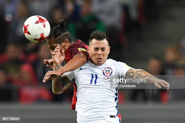 TOPSHOT Portugal's defender Bruno Alves vies with Chile's forward Eduardo Vargas during the 2017 Confederations Cup semifinal football match between...