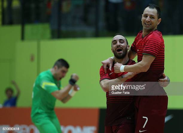 Portugal's defender Cardinal celebrates with Ricardinho after scoring a goal during the FIFA Futsal playoff match between Portugal and Serbia at...